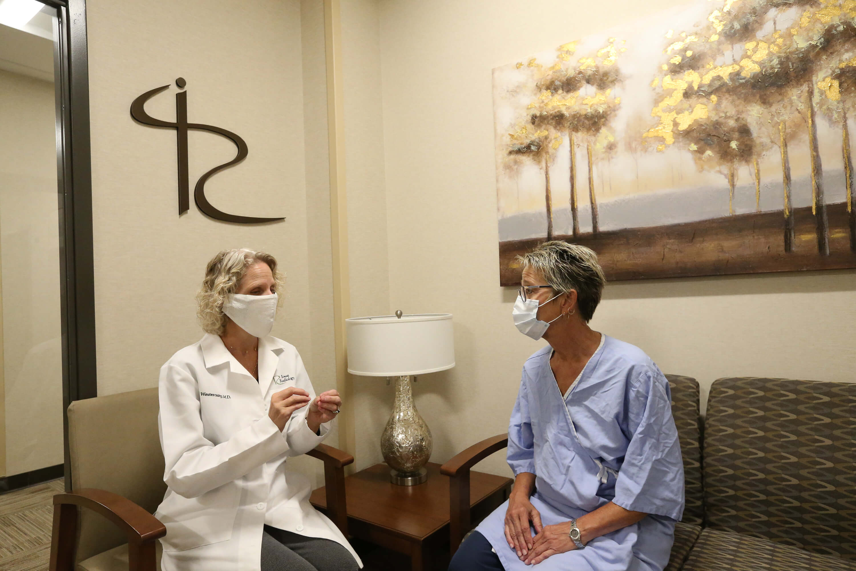 doctor-discussing-treatment-with-patient